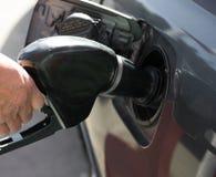 Petrol pump. A male's hand filling petrol stock photos