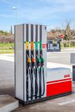 Petrol pump nozzles on a gas service station. LYON, FRANCE - FEBRUARY 26, 2019: Petrol pump nozzles on a AVIA gas service station. Day shot royalty free stock photos