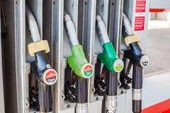 Petrol pump nozzles on a gas service station. VALENCIA, SPAIN - FEBRUARY 19, 2019: Cepsa Petrol pump nozzles on a gas service station in Valencia, Spain royalty free stock images