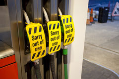 Petrol pump - out of use. Fuel pumps at a filling station with out of use sign Royalty Free Stock Photo