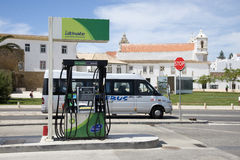 Petrol pump on roadside Europe and a passing bus Stock Photography