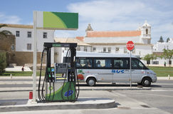 Petrol pump on roadside Europe and a passing bus Stock Photo