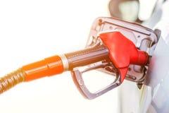 Petrol pumping gasoline at gas station. Close up image.  Stock Photos