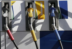 Petrol Pumps. Three Petrol Pumps, Red, Yellow, Blue Stock Photo