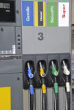 Petrol pumps. Four gas pump nozzles on the petrol station Stock Images