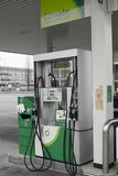 Petrol pumps at  Forecourt. View of Petrol pumps at a BP Forecourt during daytime with no people Royalty Free Stock Photos