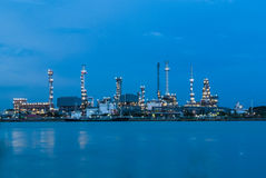 Petrol refinery station along river at twilight Stock Photo
