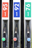 Petrol station. Fuelling nozzles with different the octane number Royalty Free Stock Photography