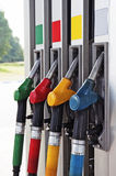 Petrol station. Four gas pump nozzles on the petrol station stock photography