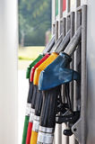 Petrol station. Four gas pump nozzles on the petrol station stock image