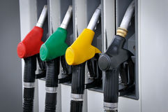 Petrol station. Four gas pump nozzles on the petrol station Royalty Free Stock Image