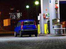 Petrol station. At night, thirsty car royalty free stock photo