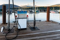 Petrol Station for Boats in a Marina. Photo of a Petrol Pump for Boats in a Marina on a Mountain Lake at Sunset. Salmon Arm, BC, Canada stock photos