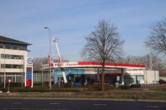 Petrol station of Esso along the road in Zwijndrecht the Netherlands. With red blue white logo on pole stock photography