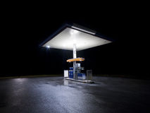 Petrol station at night. With traffic in movement stock photography