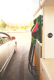 Petrol station. Row of petrol station pupmps and car close up, retro toned royalty free stock image