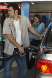 Petrol Station Worker Refueling Car Stock Photos
