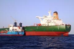 Petrol tanker STORVIKEN anchored in the middle of Algeciras bay. Petrol tanker STORVIKEN anchored in Algeciras Bay join to supplies vessel OVIT Gibraltar Rock stock image