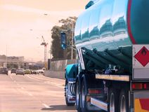 Petrol tanker traveling on a freeway stock photography