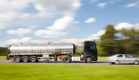 Petrol tanker truck in motion blur Royalty Free Stock Image