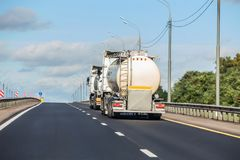 Petrol tankers transport fuel along the highway. In summer stock photos