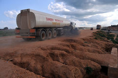 Petrol truck in Juba, South Sudan. Petrol truck driving on eroded dirt road in Juba, South Sudan, which is suffering from an acute gasoline shortage because of stock photos