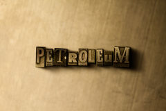 PETROLEUM - close-up of grungy vintage typeset word on metal backdrop Stock Image