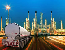 Petroleum container truck and beautiful lighting of oil refinery. Plant in  heav petrochemicaly industry estate use for power ,energy and petroleum industrial Stock Photography