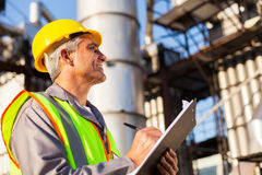 Petroleum factory worker Royalty Free Stock Image