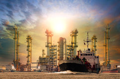 Petroleum gas container ship and oil refinery background for ene Stock Images
