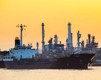 Petroleum gas container ship and oil refinery plant industry est Royalty Free Stock Images