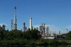 Petroleum industry. Metal pipes and smoke stacks of a modern oil petroleum industry royalty free stock photo