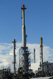 Petroleum industry. Metal pipes and smoke stacks of a modern oil petroleum industry stock images