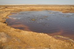 Petroleum Lake at Dallol volcano, Danakil Depression, Ethiopia. The volcanic explosion crater of Dallol in the Danakil Depresseion in Nothern Ethiopia. The Royalty Free Stock Images