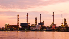 Petroleum oil refinery factory over sunrise Stock Photography