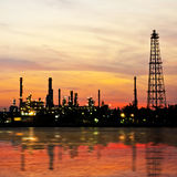 Petroleum oil refinery factory over sunrise Stock Image