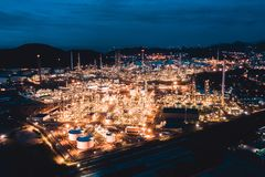 Petroleum oil refinery in industrial estate at twilight. Fuel and power generation, petrochemical factory industry concept. Aerial view of petroleum oil refinery royalty free stock photos