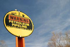 Petroleum Pipeline Warning Sign. An old warning sign for a petroleum pipeline. May be used to show environmental concerns, oil and gas industry warnings and more Royalty Free Stock Images