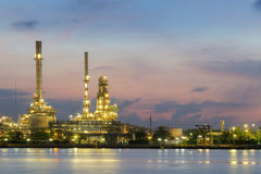 Petroleum plant river front night light with twilight sky. Background Stock Photos