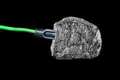 Petroleum plug. Green energy line plugged into hunk of petroleum Royalty Free Stock Photos
