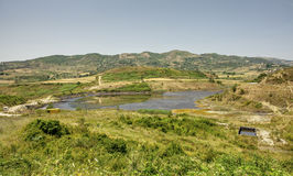 Petroleum pumping polluted landscape in Albania. Power Industry Royalty Free Stock Image