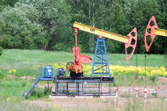 Petroleum pumps swing petroleum from a Royalty Free Stock Photography