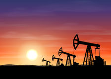 Petroleum rigs at sunset. Oil drill background. Vector illustration. Royalty Free Stock Photos