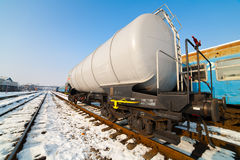 Petroleum tank on railway. In a sunny winter day Stock Photo