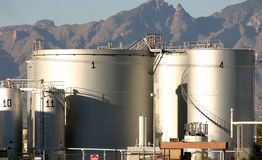 Petroleum Tanks. Tank farm for petroleum products in Tucson Arizona showing taniks access stairs articulated stars to the floating tank tops with the Catalina royalty free stock photography