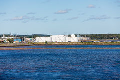 Petroleum Tanks on Blue Shore Royalty Free Stock Images