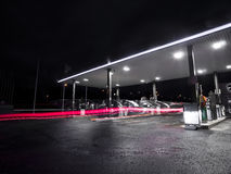 Petrolstation at night. Petrol station at night, automatic benzine cars dark diesel evening exposure filling gas gasoline light lights long movement neon night Stock Images