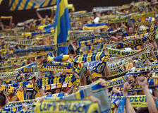 Petrolul Ploiesti football fans cheering. Petrolul Ploiesti football fans with scarves cheering for their team during Romanian Cup Final Royalty Free Stock Photography
