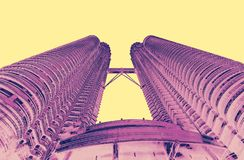 Petrona towers in KL Malaysia in bright. Pink and yellow duo tone stock images