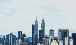 Petronas torreggia su Kuala Lumpur Immagine Stock